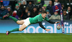Ireland's Jacob Stockdale scores his sides third try during the NatWest 6 Nations match at Twickenham Stadium, London.