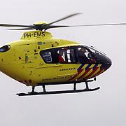 Dodelijk ongeval Randweg Huizen, traumahelicopter.politie, beknelling, verkeer, brandweer, ambulance, trauma, VU, heli, lifeliner