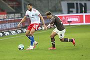 Fussball: 2. Bundesliga, FC St. Pauli - Hamburger SV, Hamburg, 01.03.2021<br /> Josha Vagnomann (HSV, l.) - Rodrigo Zalazar (Pauli)<br /> © Torsten Helmke