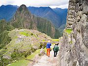 The Incan ruins of Machu Picchu, with Huayna PIcchu rising in the background, near Aguas Calientes, Peru.