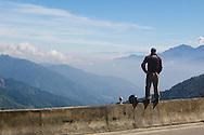A motorcyclist takes a break on Ali Shan Mountain in Taiwan.