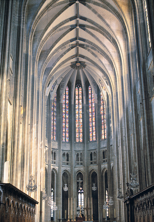 Sunlight lights the beautiful stained-glass windows in the nave of Cathedral Ste-Croix in Orleans, Loire Valley, France.