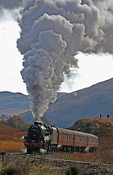 The Jacobite steam train LMS Stanier Class 5 4-6-0 45407 'The Lancashire Fusilier' just after departing Glenfinnan station on route to Mallaig. This journey has been made famous in The Hogwarts Express in the Harry Potter films....... (c) Stephen Lawson | Edinburgh Elite media