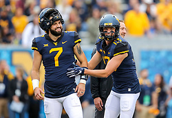 Sep 8, 2018; Morgantown, WV, USA; West Virginia Mountaineers quarterback Will Grier (7) and West Virginia Mountaineers wide receiver David Sills V (13) talk before their game against the Youngstown State Penguins at Mountaineer Field at Milan Puskar Stadium. Mandatory Credit: Ben Queen-USA TODAY Sports