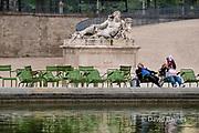 France, Paris, Couple relaxing in Tuileries Garden
