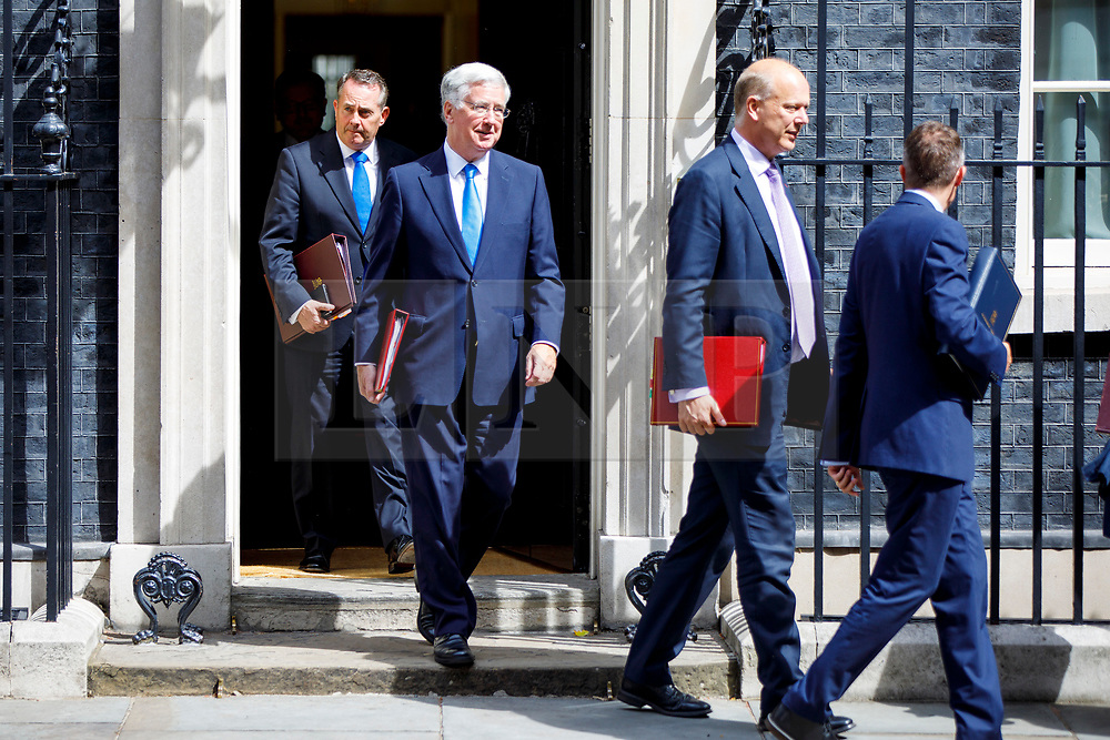 © Licensed to London News Pictures. 18/07/2017. London, UK. International Trade Secretary LIAM FOX, Defence Secretary MICHAEL FALLON and Transport Secretary CHRIS GRAYLING leave after a cabinet meeting in Downing Street, London on Tuesday, 18 July 2017. Photo credit: Tolga Akmen/LNP