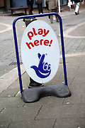 National Lottery play here sign in street