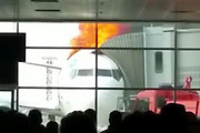 Plane catches fire while at Gate in Kazakhstan Airport<br /> <br /> Imagine you wait to board your plane in an airport and your plane has arrived to the gate, so the boarding is about to begin. Then in an instant the Boeing 737 catches on huge fire with flames bursting thruogh its top. This is what happened a few days ago in Kazakhstan airport. Happily, nobody was injured except one Latvian engineer who worked for a local air company. They say that the reasons why this happened are still unclear. Some say the oxygen balloon  exploded (the one that feeds the emergency masks).<br /> ©Exclusivepix Media