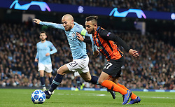 Manchester City's David Silva (left) and Shakhtar Donetsk's Maycon battle for the ball during the UEFA Champions League match at the Etihad Stadium, Manchester.