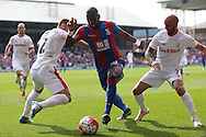 Yannick Bolasie of Crystal Palace © goes past Erik Pieters of Stoke City and Stephen Ireland of Stoke City (r). Barclays Premier League match, Crystal Palace v Stoke City at Selhurst Park in London on Saturday 7th May 2016. pic by John Patrick Fletcher, Andrew Orchard sports photography.