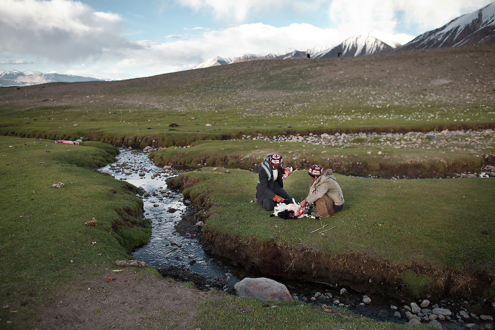 Slaughtering a sheep at the summer camp of Muqur, Er Ali Boi's place...Trekking through the high altitude plateau of the Little Pamir mountains (average 4200 meters) , where the Afghan Kyrgyz community live all year, on the borders of China, Tajikistan and Pakistan.