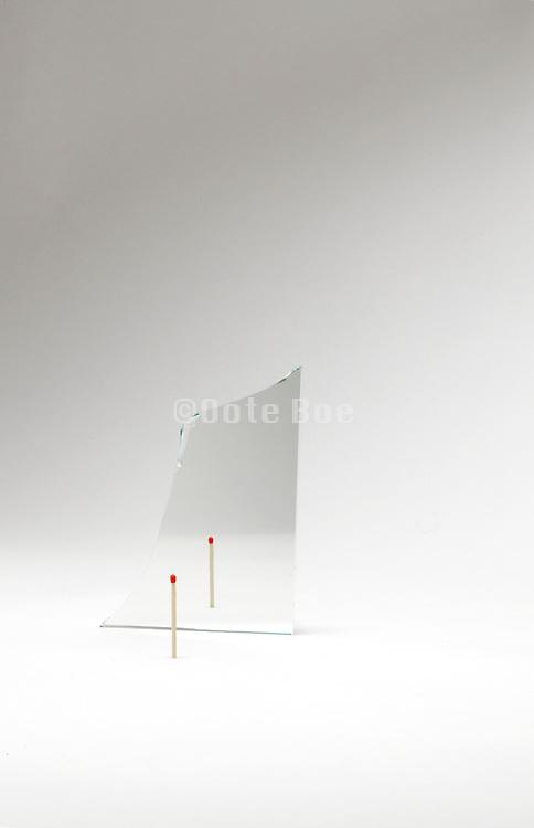 broken mirror with a match