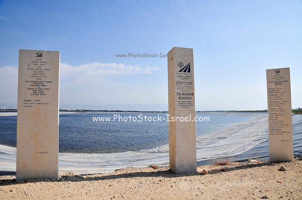 Rain water reservoir (constructed by the JNF). Memorial signs for the donors. Water shortage has increased the amount of water that is dammed of and collected in reservoir for domestic and agricultural use. This water storage is damaging the natural environment as not enough water is reaching the streams to sustain the ecosystem Israel, Beit Shean Valley