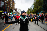 A masked woman leads a group pf protesters marching in Bourke Street during a Black Lives Mater rally on 06 June, 2020 in Melbourne, Australia. This event was organised to rally against aboriginal deaths in custody in Australia as well as in unity with protests across the United States following the killing of an unarmed black man George Floyd at the hands of a police officer in Minneapolis, Minnesota. (Photo by Dave Hewison/ Speed Media)