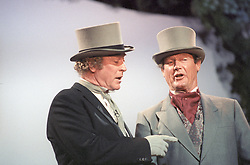 File photo dated 19/07/90 of actors Michael Caine and Roger Moore rehearsing at the London Palladium for the Queen Mother's royal birthday gala. Sir Roger has died in Switzerland after a short battle with cancer, his family has announced.