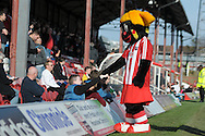 Brentford Mascot 'Buzzette' greeting his young fans. Skybet football league one match , Brentford v Bradford City at Griffin Park in Brentford, London  on Saturday 8th March 2014.<br /> pic by John Fletcher, Andrew Orchard sports photography.