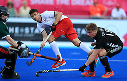 England's Phillip Roper gets a shot in on goal infant of Wales' Gareth Ferlong at the Gold Coast Hockey Centre during day six of the 2018 Commonwealth Games in the Gold Coast, Australia.