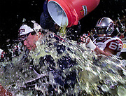 Montreal Alouettes coach Don Matthews (L) has Gatorade dumped on him by Alouettes center Bryan Chiu on his way to his record 200th career CFL win in Ottawa, October 26, 2002. The Alouettes defeated the Ottawa Renegades, 43-34.       REUTERS/Jim Young