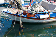 A colourful wooden fishing boat in the Kassiopi harbour on Corfu, The Ionian Islands, The Greek Islands, Greece, Europe