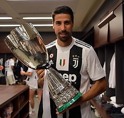 """Sami Khedira releases a photo on Instagram with the following caption: """"One more... \ud83c\udfc6\u2728 #Supercoppa #ForzaJuve #SK6"""". Photo Credit: Instagram *** No USA Distribution *** For Editorial Use Only *** Not to be Published in Books or Photo Books ***  Please note: Fees charged by the agency are for the agency's services only, and do not, nor are they intended to, convey to the user any ownership of Copyright or License in the material. The agency does not claim any ownership including but not limited to Copyright or License in the attached material. By publishing this material you expressly agree to indemnify and to hold the agency and its directors, shareholders and employees harmless from any loss, claims, damages, demands, expenses (including legal fees), or any causes of action or allegation against the agency arising out of or connected in any way with publication of the material."""