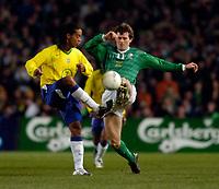 Photo. Jed Wee.<br /> Republic of Ireland v Brazil, International Friendly, Lansdowne Road, Dublin. 18/02/2004.<br /> Brazil's Ronaldinho (L) and Ireland's Kevin Kilbane scrap for possession.