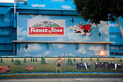 "Mural on the side Farmer John meat processing plant in Vernon. Farmer John produces a variety of Pork products. Located just a few miles from downtown Los Angeles, Vernon's official slogan is ""Exclusively Industrial"" and at the last census had a population of 91. Los Angeles, California, USA"