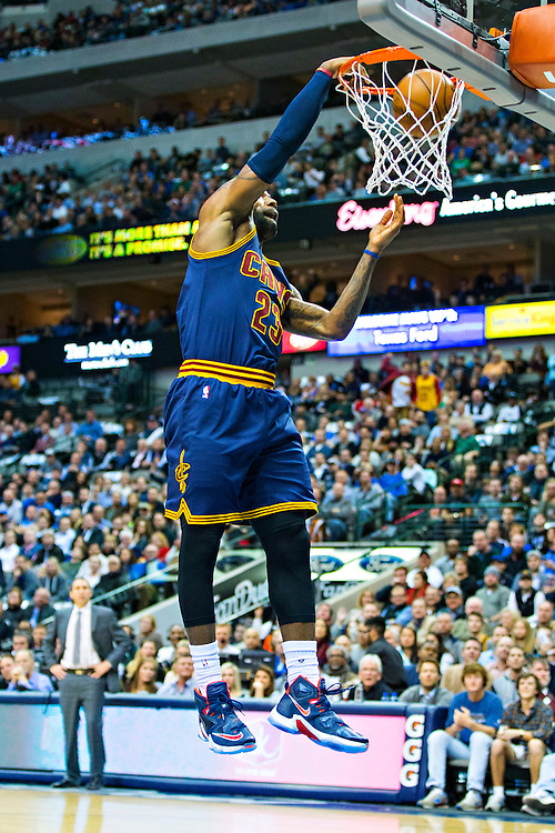 DALLAS, TX - JANUARY 12:  Lebron James #23 of the Cleveland Cavaliers dunks the basketball while posing for the cameras during a game against the Dallas Mavericks at American Airlines Center on January 12, 2016 in Dallas, Texas.  NOTE TO USER: User expressly acknowledges and agrees that, by downloading and or using this photograph, User is consenting to the terms and conditions of the Getty Images License Agreement.  The Cavaliers defeated the Mavericks 110-107.  (Photo by Wesley Hitt/Getty Images) *** Local Caption *** Lebron James