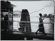Woman walking across gangway