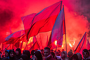 Flares, masks and smoke - Thousands of Fascists and other far-right extremists from all over Europe march under the Slogan 'We want God'. The organisers include the National-Radical Camp, the National Movement and the All Polish Youth. Polish independence day, Warsaw, Poland. Warsaw 11 Nov 2017