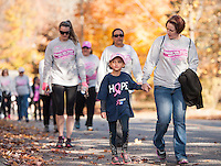 A steady flow of walkers during the annual Making Strides Against Breast Cancer walk through Laconia on Sunday morning.  (Karen Bobotas/for the Laconia Daily Sun)