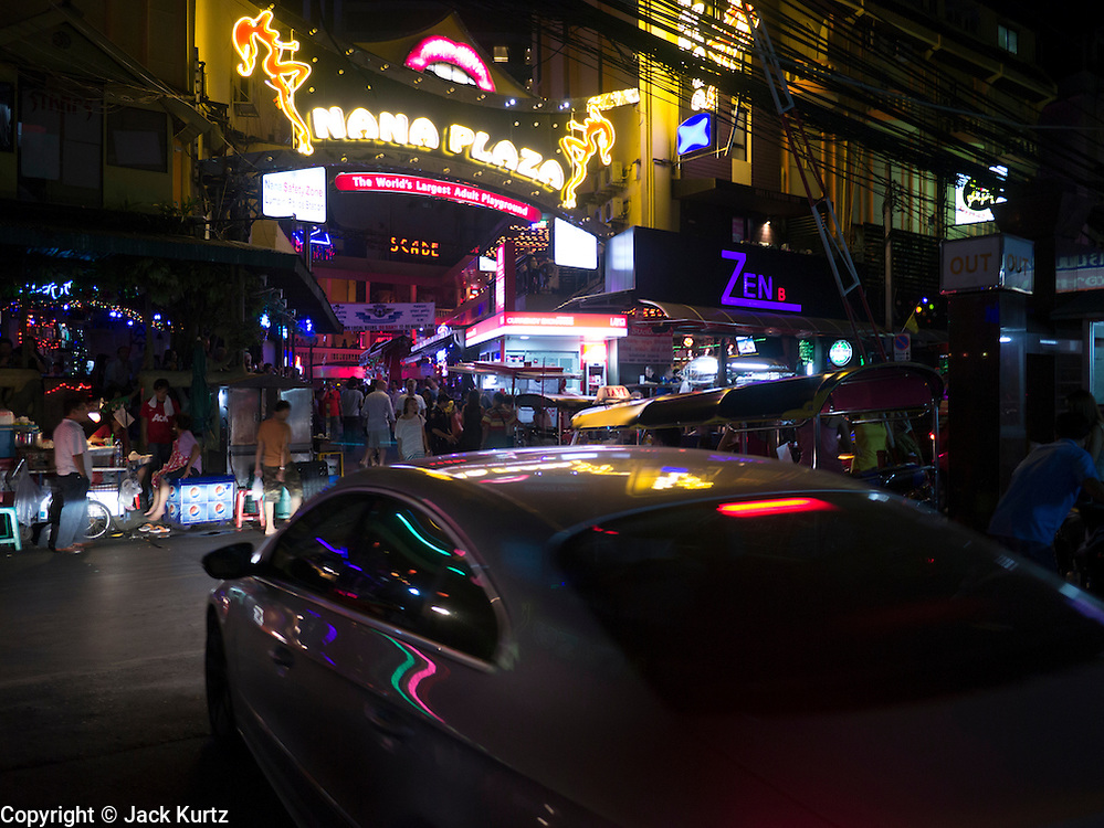 "05 JANUARY 2013 - BANGKOK, THAILAND: Entrance of the Nana Entertainment District, a warren of bars and brothels in central Bangkok. Prostitution in Thailand is technically illegal, although in practice it is tolerated and partly regulated. Prostitution is practiced openly throughout the country. The number of prostitutes is difficult to determine, estimates vary widely. Since the Vietnam War, Thailand has gained international notoriety among travelers from many countries as a sex tourism destination. One estimate published in 2003 placed the trade at US$ 4.3 billion per year or about three percent of the Thai economy. It has been suggested that at least 10% of tourist dollars may be spent on the sex trade. According to a 2001 report by the World Health Organisation: ""There are between 150,000 and 200,000 sex workers (in Thailand).""      PHOTO BY JACK KURTZ"