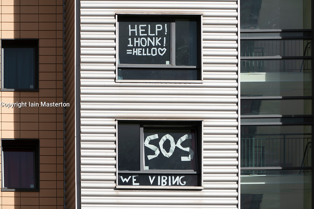 Dundee, Scotland, UK. 25 September, 2020. Students have posted protest signs and messages on windows of their rooms in Parker House hall of residence at Abertay University in Dundee. Following many positive tests for Covid-19 amongst students living in the block, students have controversially been told to self-isolate indoors and not meet others outside the building.  Iain Masterton/Alamy Live News