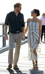 The Duke and Duchess of Sussex walk along Kingfisher Bay Jetty on Fraser Island, Queensland, on day seven of the Duke and Duchess of Sussex's visit to Australia.