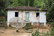 The home of D. Maninha, aged 94, one of the oldest inhabitants. Pylons, Cubatão, Brazil, 2008