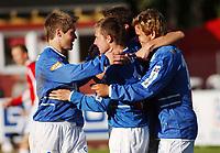 Amund Skiri, Aalesund, gratulerer en jublende Morten Moldskred, Aalesund, for sitt mål. Bakerst: Joakim Austnes, Aalesund. <br /> <br /> Fotball: Kongsvinger - Aalesund 2-2 (5-2 e. straffer). NM 2004 herrer, 3. runde. 8. juni 2004. (Foto: Peter Tubaas/Digitalsport.