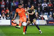 Luton Town Defender James Justin (2) and AFC Wimbledon Defender Toby Sibbick (20) battle for the ball during the EFL Sky Bet League 1 match between Luton Town and AFC Wimbledon at Kenilworth Road, Luton, England on 23 April 2019.