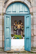 Cupboard shrine - typical religious art in quaint town of Guimaraes in Northern Portugal