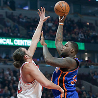 17 December 2009: New York Knicks center Eddy Curry goes for a skyhook over Chicago Bulls center Joakim Noah during the Chicago Bulls 98-89 victory over the New York Knicks at the United Center, in Chicago, Illinois, USA.