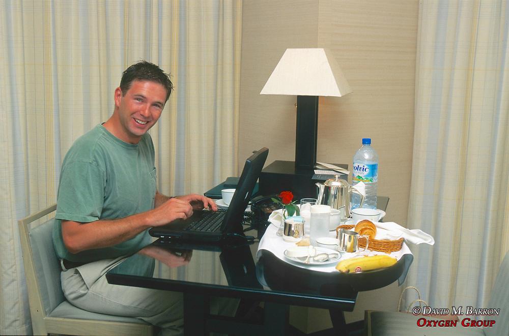 J. NIchols Working In Hotel Room