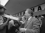 "Taoiseach's Election Campaign.      (N77)..1981..23.05.1981..05.23.1981..23rd May 1981..On the 21st May the Taoiseach, Mr Charles Haughey, dissolved the Dáil and called a general election. Charles Haughey, Garret Fitzgerald and Frank Cluskey were leading their respective parties into a general election for the first time as they had only taken party leadership during the last Dáil..Fianna Fáil had hoped to call the election earlier, but the Stardust Tragedy caused the decision to be deferred...Picture shows Charles Haughey TD sampling a slice of ""Gur cake"" on his visit to  Ballyfermot Shopping Centre."