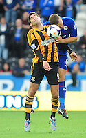 Cardiff City's Ben Turner goes up for a header with Hull City's Danny Graham <br /> <br /> Photo by Chris Vaughan/CameraSport<br /> <br /> Football - Barclays Premiership - Hull City v Cardiff City - Saturday 14th September 2013 - Kingston Communications Stadium - Hull<br /> <br /> © CameraSport - 43 Linden Ave. Countesthorpe. Leicester. England. LE8 5PG - Tel: +44 (0) 116 277 4147 - admin@camerasport.com - www.camerasport.com