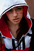 Anais Roberts as Emiliana Santi from Assasins Creed: Brotherhood attending<br /> The London Film and Comic Con. Assassin's Creed Brotherhood is a historical<br /> third person, stealth action-adventure video game developed by Ubisoft. The<br /> London Film and Comic Con LFCC is a convention held annually in London that<br /> focuses on films, cult television and comics. The convention holds a large<br /> dealers hall selling movie, comic and science fiction related memorabilia<br /> and original film props, along with free guest talks, professional photo<br /> shoots, autograph sessions, displays. Many of the visitors / attendees<br /> arrive dressed up as their favourite comic and sci-fi characters in the most<br /> outlandish costumes