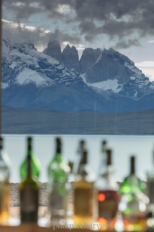 Alcohol bottles on bar in Tierra Patagonia Hotel with mountain view, Torres del Paine National Park, Patagonia, Chile