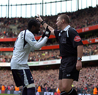 Photo: Olly Greenwood.<br />Arsenal v Tottenham Hotspur. The Barclays Premiership. 02/12/2006. Spurs Pascal Chimbonda pleads to referee Graham Poll not to give a penalty