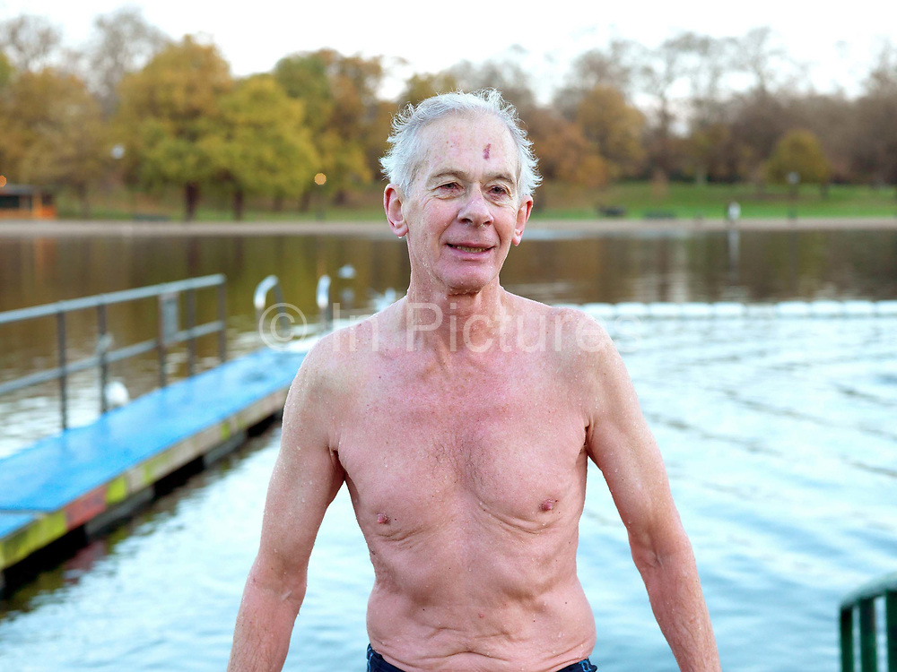Portrait of a member of the Serpentine Swimming Club, Hyde Park, London, UK. The Serpentine Lake is situated in Hyde Park, London's largest central open space. The Serpentine Swimming Club was formed in 1864 'to promote the healthful habit of bathing in open water throughout the year'.  Its headquarters were beneath an old elm tree on the south side of the lake, a wooden bench for clothing being the only facility.  At this time London was undergoing rapid expansion and Hyde Park was now in the centre of a densely populated built up area and provided a place of relaxation to its urbanised masses. Now, the club has its own (somewhat spartan) changing facilities and members are  permitted by the Royal Parks to swim in the lake any morning before 09:30.  They race every Saturday morning throughout the year, regardless of the weather.