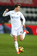 Tom Carroll of Swansea city flicks the ball backwards. Premier league match, Swansea city v Leicester City at the Liberty Stadium in Swansea, South Wales on Sunday 12th February 2017.<br /> pic by Andrew Orchard, Andrew Orchard sports photography.