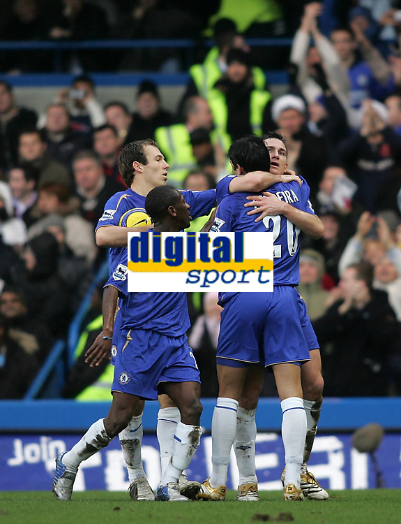 Photo: Lee Earle.<br /> Chelsea v Fulham. The Barclays Premiership. 26/12/2005. Chelsea's Frank Lampard (R) is congratulated after scoring their second goal.