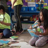 Janyka Billie, right, and Mariana Enriquez, put books in boxes in a classroom at Lincoln Elementary School in Gallup Tuesday. The school will transition to a new building at the end of the week.