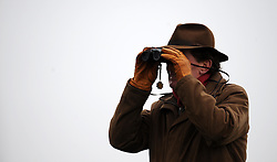 A racegoer looks on during the Bathwick Tyres Handicap Chase (Class 3) (5YO plus) - Photo mandatory by-line: Harry Trump/JMP - Mobile: 07966 386802 - 09/03/15 - SPORT - Equestrian - Horse Racing - Taunton Racing - Taunton Racecourse, Somerset, England.