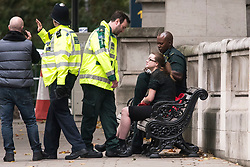© Licensed to London News Pictures. 07/10/2017. London, UK.  an Injured woman being treated at the scene of an incident outside the Natural History Museum. Early reports say a man has been arrested after pedestrians were injured in a collision with a car. Photo credit: Ben Cawthra/LNP